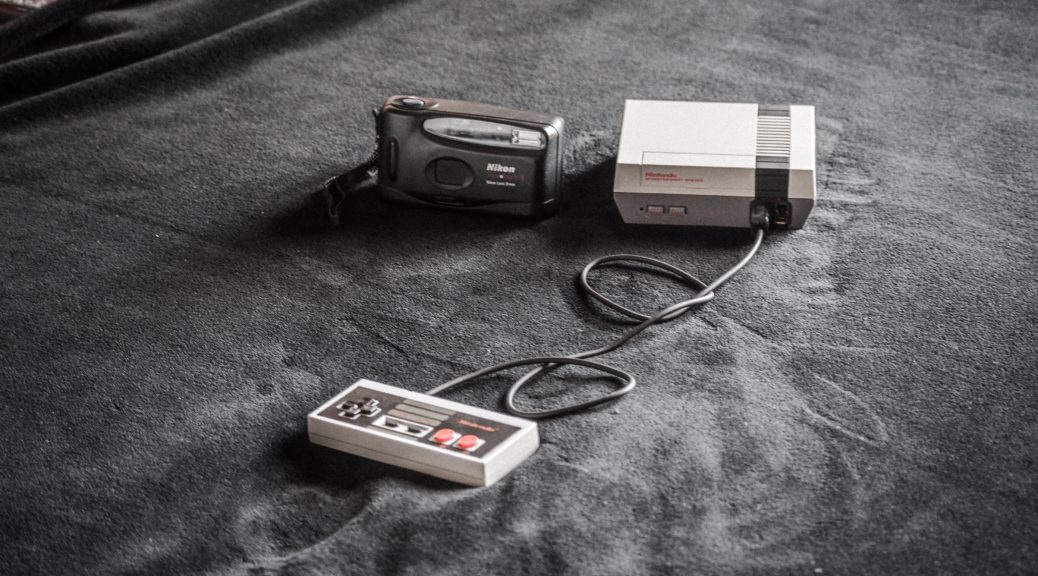 NES console beside black camera